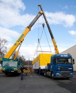 Two cranes were needed to handle the weight of the furnace during loading.